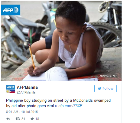 Philippine boy studying on street by a McDonalds swamped by aid after photo goes viral