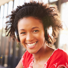 Black Women Smiling with head phones
