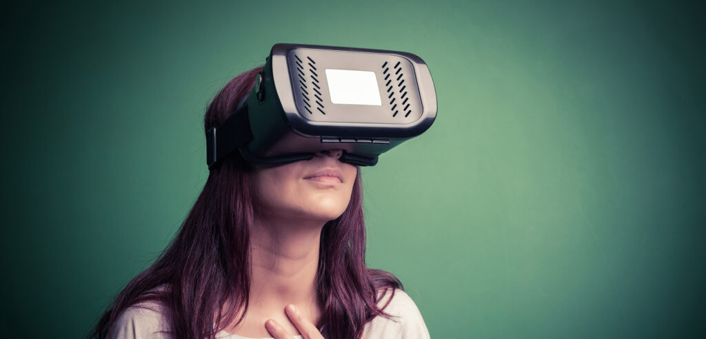 girl using virtual reality goggles