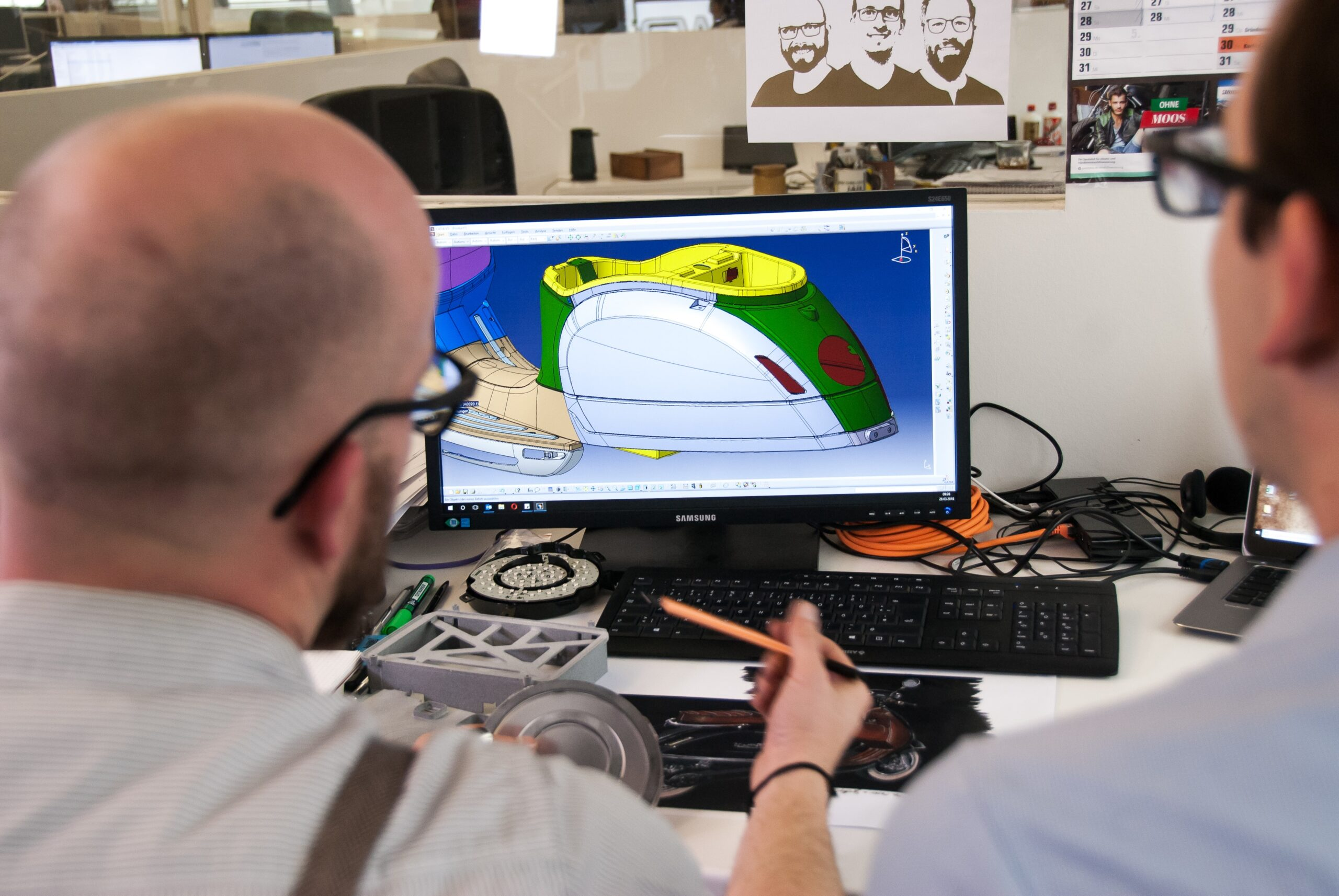 two people looking at a CAD software