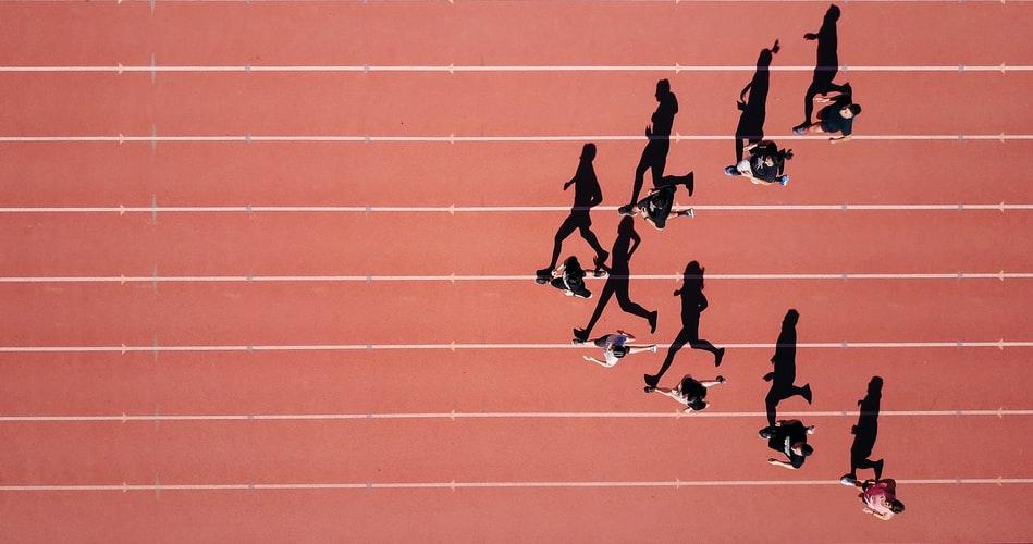 girls running on a court